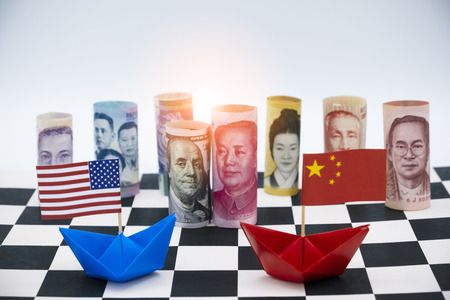 Blue ship and red ship with USA and China flags. Its is symbol for tariff trade war crisis between United stated of america and China which its are biggest economic country in the world.