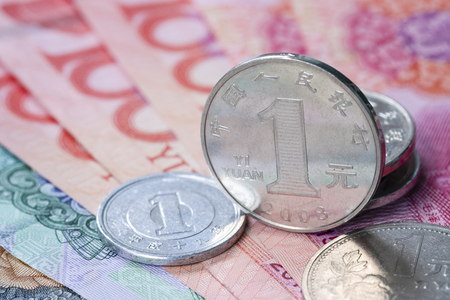Closeup China Yuan coins and banknote for exchange saving and investment concept.