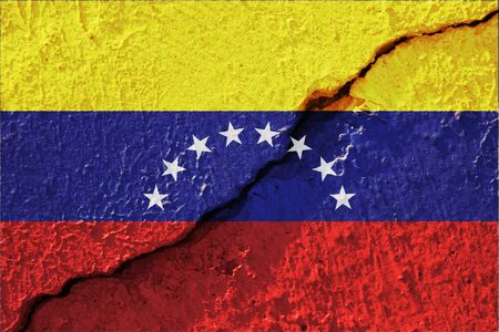Colourful Venezuela flag on broken crack concrete for background and texture. Venezuela country have extreme inflation crisis after crude oil price very low.