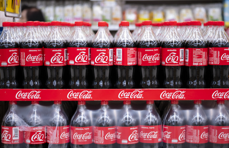 BANGKOK, THAILAND - MAY 23, 2019: Coca-Cola logo printed on plastic bottle and placed on shopping mall. Coca-Cola is a carbonated soft drink sold in stores and restaurants throughout the world. Standard-Bild - 124999316