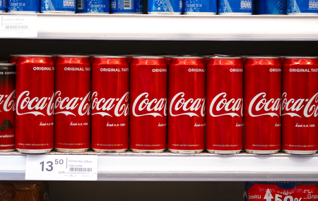BANGKOK, THAILAND - MAY 23, 2019: Coca-Cola logo printed on aluminium can and placed on shopping mall. Coca-Cola is a carbonated soft drink sold in stores and restaurants throughout the world. 스톡 콘텐츠 - 124999330