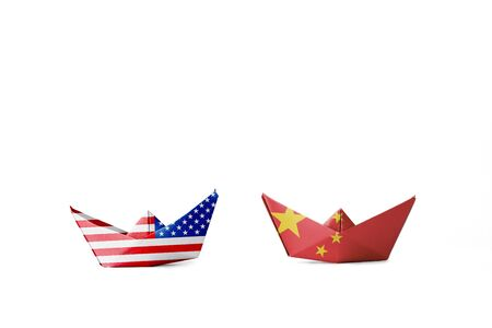 USA flag and China flag print screen on ship with white background.It is symbol of tariff trade war tax barrier between United States of America and China. Reklamní fotografie