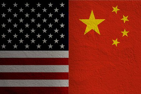 Closeup separate of USA flag and China flag .It is symbol of tariff trade war crisis between United States of America and China which the biggest economic country in the world.