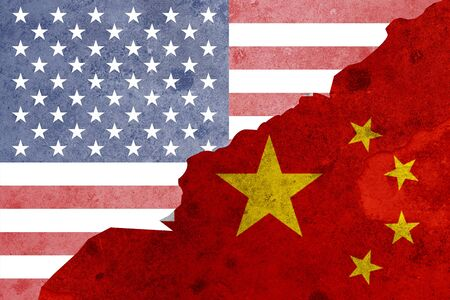 Closeup crack of USA flag and China flag .It is symbol of tariff trade war crisis between United States of America and China which the biggest economic country in the world. Zdjęcie Seryjne