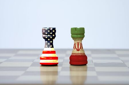 USA flag and Iran flag print screen on chess with white background.It is symbol of United state of America and Iran have conflict in nuclear weapons and Strait of Hormuz.-Image.