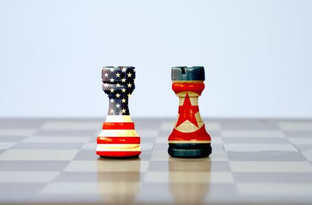 USA flag and North Korea flag print screen on chess with white background.It is symbol of United states of America sanction with North Korea in tension nuclear weapon. Zdjęcie Seryjne