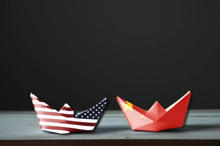 USA flag and China flag print screen on ship with black background.It is symbol of tariff trade war tax barrier between United States of America and China.-Image.