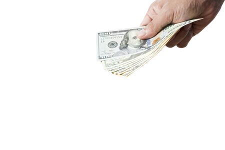 Hand hold and give dollar banknote on white background. Give and payment concept. Stock Photo