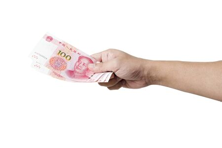 Hand hold and give Yuan banknote on white background. Give and payment concept.