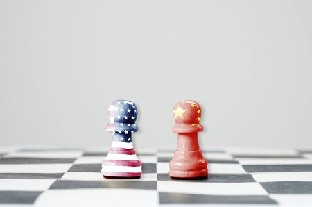 USA flag and China flag print screen on chess with white background.It is symbol of tariff trade war tax barrier between United States of America and China.-Image. 스톡 콘텐츠