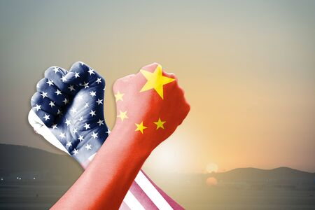 Arm wrestle of USA flag and China flag on sunrise and landscape background.United States of America versus China trade war disputes concept. - Image