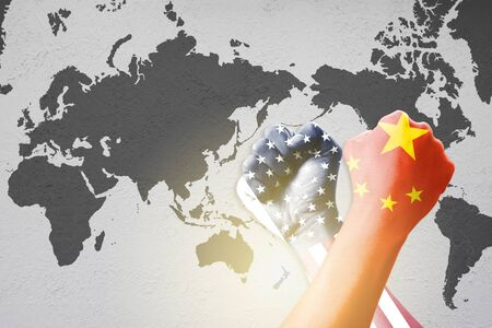 Print screen USA and China flag on hand across wrestle on world map background.United States of America versus China trade war disputes concept. - Image 스톡 콘텐츠