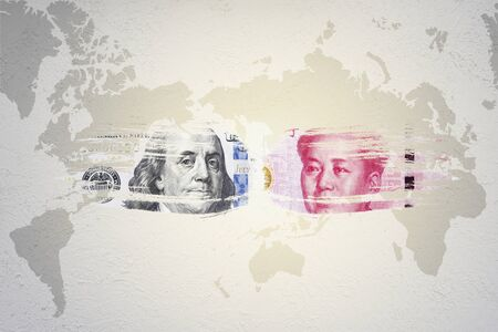 US dollar and Yuan banknote on world map which it symbol of United states of America and China economic tariff trade war crisis. Copy space and illustration. 스톡 콘텐츠
