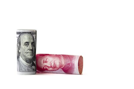 Face to face of Benjamin Franklin and Mao Tse tung from US dollar and China Yuan banknote. It is symbol of economic tariffs trade