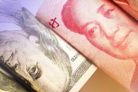 Face to face of Benjamin Franklin and Mao Tse tung from US dollar and China Yuan banknote. It is symbol of economic tariffs trade war.