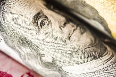 Closeup of Benjamin Franklin from US dollar banknote. USD is the main of currency exchange in the world. 스톡 콘텐츠