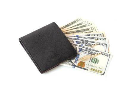 US dollar inside Wallet on white background. US dollar is main and popular currency of exchange in the world. Investment and saving concept.