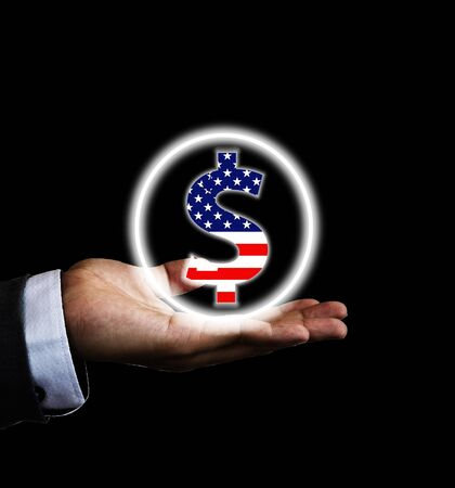 US dollar sign on hand of businessman with black background. US dollar is main and popular currency of exchange in the world. Investment and saving concept.