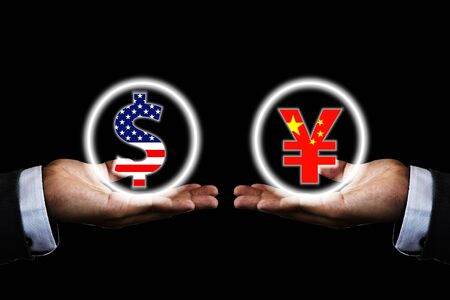 US dollar and China Yuan sign on hand of businessman with black background. It is symbol of economic tariff trade war and reduce exchange currency between USA and China. 스톡 콘텐츠