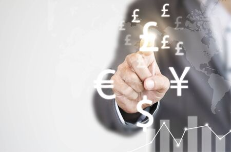 Businessman finger touch to Pound sterling sign among YEN US dollar and  EURO sign currency.Pound Sterling  is main and popular currency of exchange in the world.Investment and saving concept.