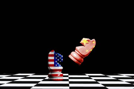 USA and China flag print screen on horse chess with black background.It is symbol of economic tariffs trade tax barrier between United States of America and China.