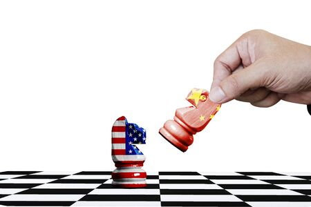 USA and China flag print screen on horse chess with white background.It is symbol of economic tariffs trade tax barrier between United States of America and China. Фото со стока