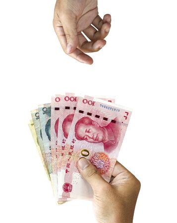 One hand holding China Yuan banknote for giving and blank one hand wait receiving it. Payment concepts.