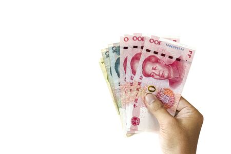 One hand holding China Yuan banknote for giving on white background. Payment and isolated photo concepts.