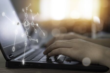 Virtual cloud and icon with hand use laptop to download and upload technology information. Technology transformation and disruption change to new normal. Zdjęcie Seryjne - 146350276