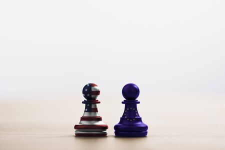 USA flag and EU flag print screen on pawn chess for battle.It is symbol of United States of America increase tariff tax barrier for import product from EU countries.-Image. Zdjęcie Seryjne - 146350309