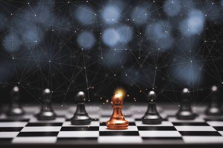 Red pawn chess stepped out of line to leading black chess and show different thinking ideas. Business technology change and disruption for new normal concept. Stock Photo