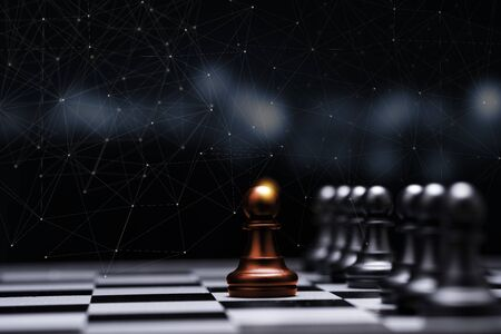 Red pawn chess stepped out of line to show different thinking ideas and leadership. Business technology change and disruption for new normal concept. Stock Photo