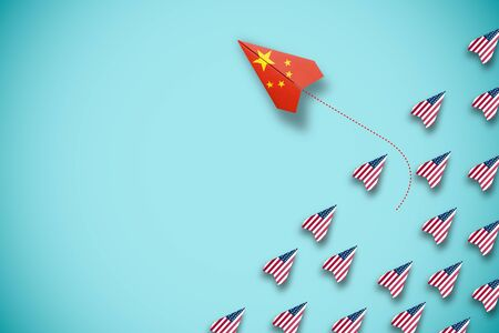 China flag print screen on paper plane flying and out of line with USA plane. China country is competitor with United States of America and barrier trade war crisis.