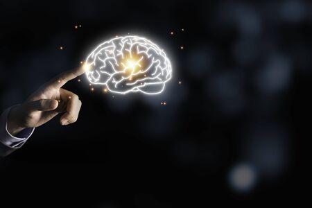 Businessman holding the blue virtual brain. Creative new business idea concept.