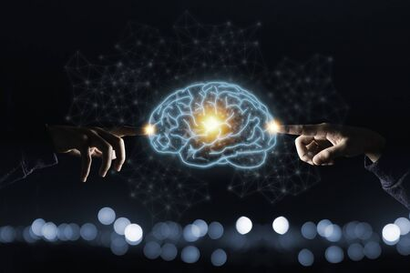 Two hands touching the virtual brain. Creative new business idea concept.