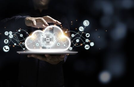 Businessman holding tablet with artificial intelligence virtual cloud computing and business icon. Cloud technology management for big data include business strategy , customer service.