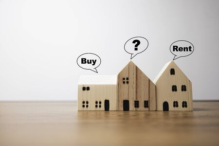 Three house with buy rent and question mark wording.It is s a choice for best selection.