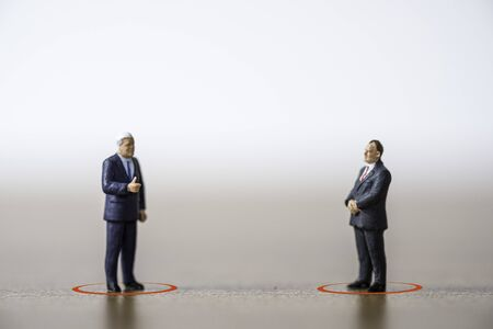Two businessman manager standing and discussion by keep social distancing to prevent COVID-19 corona virus outbreak spread pandemic infection. Social distancing concept. Zdjęcie Seryjne