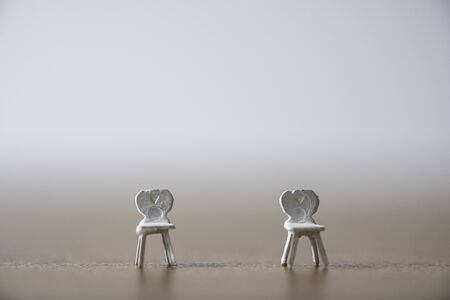 White miniature chair keep distance at public and prevent COVID-19 corona virus outbreak spread pandemic infection. Social distancing concept. Zdjęcie Seryjne