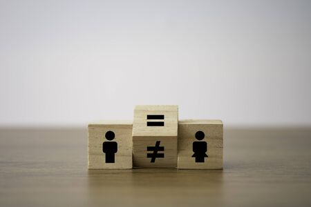 Flipping of unequal to equal sign between man and woman. Human and business right concept.