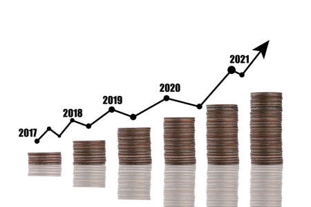 Coin stacking with virtual trend graph on white background.Business investment growth and profit increase concept.