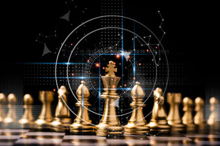Golden king chess stand in front of others chess pieces. Leadership business teamwork and marketing strategy planing concept. Фото со стока - 151814232