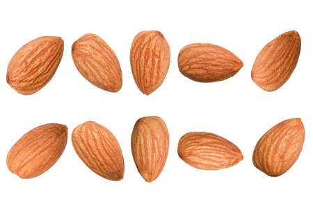 Closeup isolated of fresh almonds nut seed with green leaves on white background.