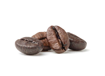 Single fresh roasted dark brown arabica coffee beans isolated on a white background