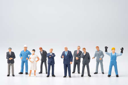 Different occupation job in people group , Miniature figure on white background. Stockfoto