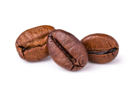 Three fresh roasted dark brown arabica coffee beans isolated on a white background with clipping path. 스톡 콘텐츠