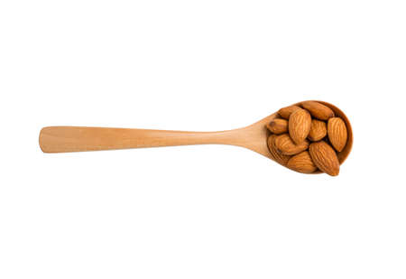 Isolated of brown fresh almonds nut inside wooden spoon on white background.