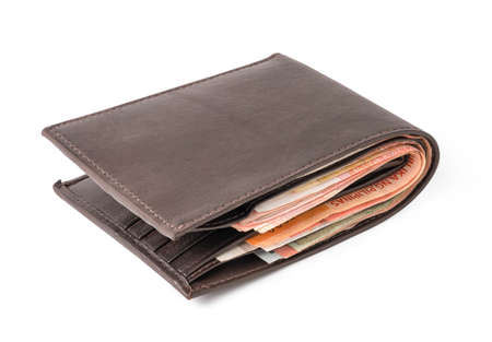 Isolated of brown leather wallet with money banknotes on white background.