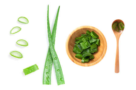 Isolated of Top view green fresh Aloe vera leaf are sliced in wooden bowl and spoon on white background.Aloe Vera is herbal for treatment skin and hair.