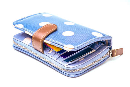 Isolated of blue and white dot leather wallet with money banknotes and credit card on white background.